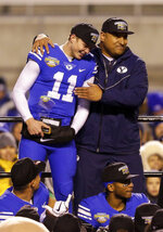 BYU head coach Kalani Sitake, top right, hugs BYU quarterback Zach Wilson (11) after winning the Famous Idaho Potato Bowl NCAA college basketball game against Western Michigan, Friday, Dec. 21, 2018, in Boise, Idaho. (AP Photo/Steve Conner)