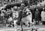 FILE - In this Jan. 11, 1970, file photo, Kansas City Chiefs running back Mike Garrett, right, celebrates with Otis Taylor after scoring a touchdown on a 5-yard run in the second quarter of the Super Bowl IV football game against the Minnesota Vikings, in New Orleans. For the second year in a row, a heavily favored NFL team lost to a supposedly weaker AFL opponent in pro football's championship game, when the Vikings fell to the Kansas Chiefs, 23-7. (AP Photo/File)
