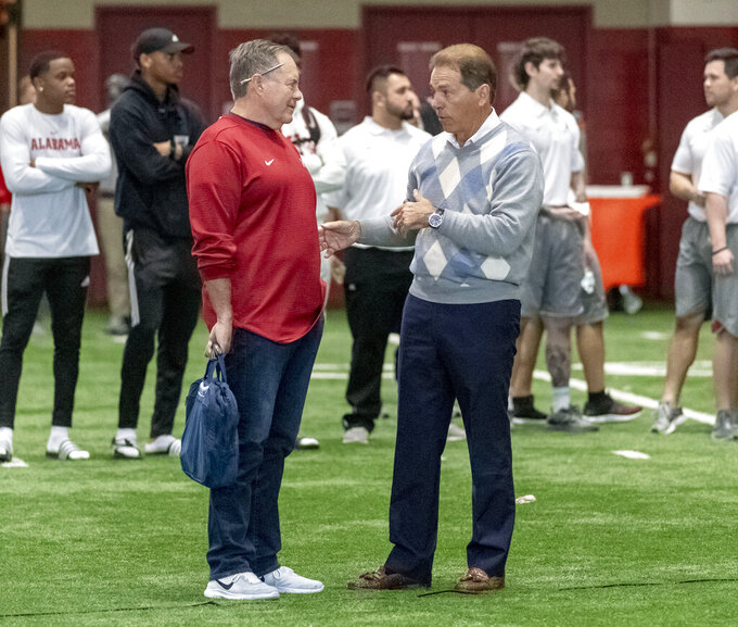 New England Patriots head coach Bill Belichick, left, talks with Alabama football coach Nick Saban at Alabama's NFL Pro Day, Tuesday, March 19, 2019, in Tuscaloosa, Ala. (AP Photo/Vasha Hunt)