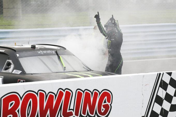 Ty Gibbs celebrates winning the NASCAR Xfinity Series auto race at Watkins Glen International in Watkins Glen, N.Y., on Saturday, Aug. 7, 2021. (AP Photo/Joshua Bessex)