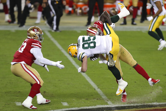 Green Bay Packers tight end Robert Tonyan (85) is tackled by San Francisco 49ers strong safety Jaquiski Tartt during the first half of an NFL football game in Santa Clara, Calif., Thursday, Nov. 5, 2020. (AP Photo/Jed Jacobsohn)