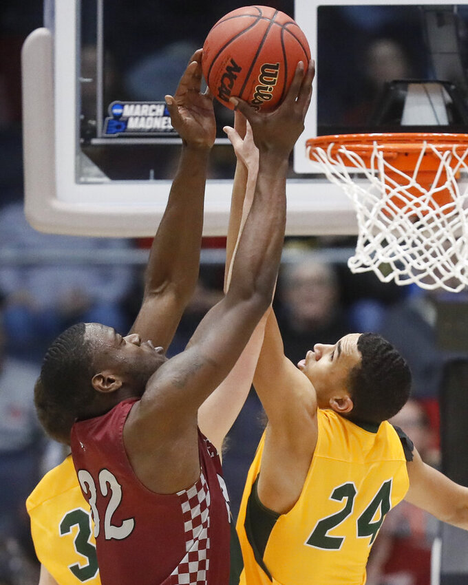 North Carolina Central's Raasean Davis (32) and North Dakota State's Tyson Ward (24) reach for a rebound during the second half of a First Four game of the NCAA men's college basketball tournament Wednesday, March 20, 2019, in Dayton, Ohio. (AP Photo/John Minchillo)