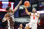 Dayton's Rodney Chatman (0) shoots against St. Bonaventure's Justin Winston (35) during the first half of an NCAA college basketball game, Wednesday, Jan. 22, 2020, in Dayton, Ohio. (AP Photo/John Minchillo)