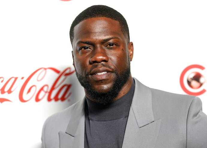 FILE - In this April 4, 2019 file photo, Kevin Hart poses for photos at the Big Screen Achievement Awards at Caesars Palace in Las Vegas. Authorities say an accident that left Kevin Hart seriously injured was caused by the man driving Hart's vintage car, who accelerated recklessly on a highway. A California Highway Patrol report released Thursday, Oct. 10, 2019 says Jared Black, who was driving the actor's 1970 Plymouth Barracuda with Hart and a woman as passengers, was turning on to Mulholland Highway near Malibu on Sept. 1 when he lost control. (Photo by Chris Pizzello/Invision/AP, File)