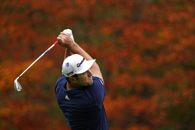 Jon Rahm, of Spain, tees off on the 11th hole during a practice round for the Masters golf tournament Tuesday, Nov. 10, 2020, in Augusta, Ga. (AP Photo/Chris Carlson)