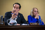 Rep. Jamie Raskin, D-Md., left, and Rep. Mary Gay Scanlon, D-Pa., argue a point as the House Rules Committee holds a markup of the resolution that will formalize the next steps in the impeachment inquiry of President Donald Trump, at the Capitol in Washington, Wednesday, Oct. 30, 2019. Democrats have been investigating Trump's withholding of military aid to Ukraine as he pushed the country's new president to investigate Democrats and the family of rival presidential contender Joe Biden. (AP Photo/J. Scott Applewhite)