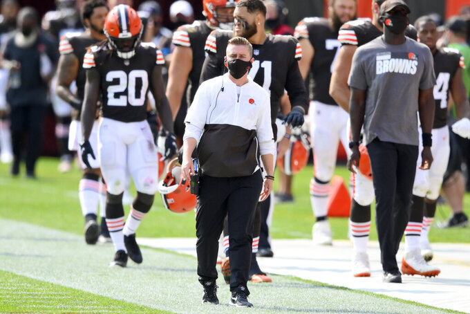Cleveland Browns chief of staff Callie Brownson, center, watches during the first half of an NFL football game against the Washington Football Team, Sunday, Sept. 27, 2020, in Cleveland. (AP Photo/David Richard)