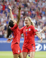 United States' Christen Press, left, celebrates with United States' Lindsey Horan after scoring her side's first goal during the Women's World Cup semifinal soccer match between England and the United States, at the Stade de Lyon, outside Lyon, France, Tuesday, July 2, 2019. (AP Photo/Alessandra Tarantino)