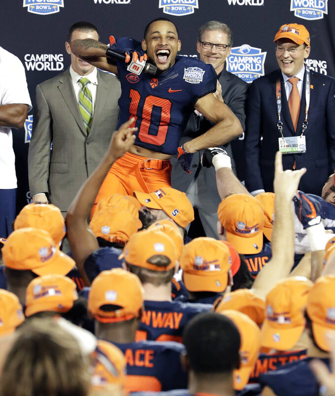 Syracuse wide receiver Sean Riley (10) leads the team in a cheer after defeating West Virginia in the Camping World Bowl NCAA college football game Friday, Dec. 28, 2018, in Orlando, Fla. (AP Photo/John Raoux)