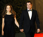 """FILE - In this Nov. 12, 2011, file photo, Actress Kelly Preston, left and her husband John Travolta arrive at the Academy of Motion Picture Arts and Sciences' 2011 Governors Awards, in Los Angeles.  Actress Kelly Preston, whose credits included the films """"Twins"""" and """"Jerry Maguire,"""" died Sunday, July 12, 2020, her husband John Travolta said. She was 57.(AP Photo/Chris Pizzello, File)"""