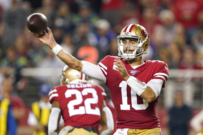 San Francisco 49ers quarterback Jimmy Garoppolo (10) passes against the Seattle Seahawks during the first half of an NFL football game in Santa Clara, Calif., Monday, Nov. 11, 2019. (AP Photo/Tony Avelar)