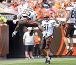 Cleveland Browns tight end David Njoku, left, celebrates with fellow tight ends after making a catch for a touchdown during an Orange and Brown NFL football practice in Cleveland, Sunday, Aug. 8, 2021. (Joshua Gunter/The Plain Dealer via AP)