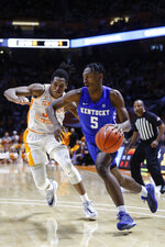 Kentucky guard Immanuel Quickley (5) drives past Tennessee guard Yves Pons (35) during the second half of an NCAA college basketball game Saturday, Feb. 8, 2020, in Knoxville, Tenn. Kentucky won 77-64. (AP Photo/Wade Payne)