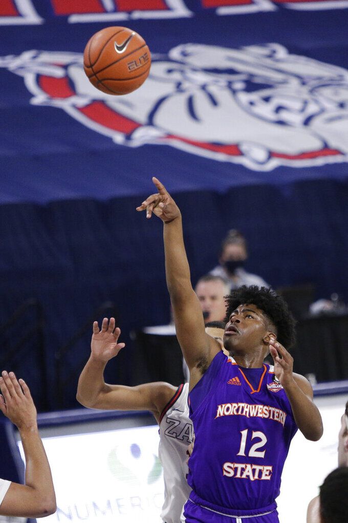 Northwestern State guard Carvell Teasett shoots during the first half of an NCAA college basketball game against Gonzaga in Spokane, Wash., Monday, Dec. 21, 2020. (AP Photo/Young Kwak)