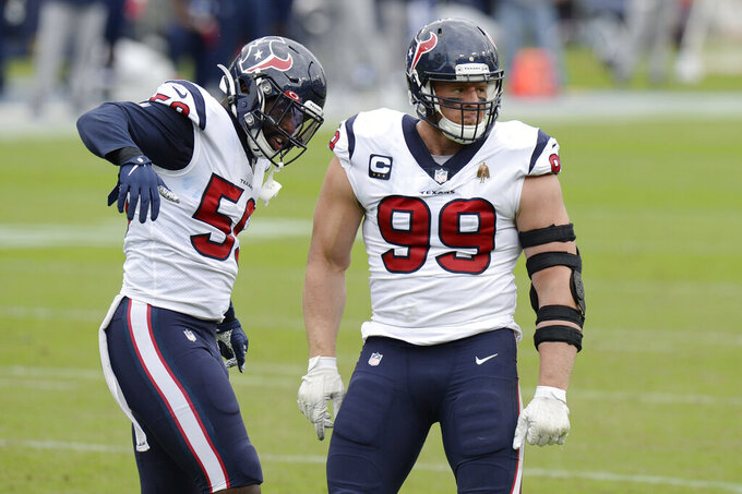 Houston Texans defensive end J.J. Watt (99) and outside linebacker Whitney Mercilus (59) celebrate after making a stop against the Tennessee Titans in the first half of an NFL football game Sunday, Oct. 18, 2020, in Nashville, Tenn. (AP Photo/Mark Zaleski)