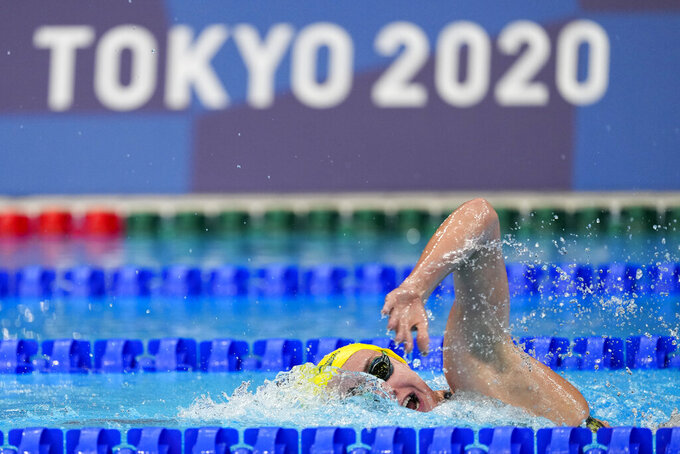 Ariarne Titmus of Australia swims in a heat of the women's 800-meter freestyle at the 2020 Summer Olympics, Thursday, July 29, 2021, in Tokyo, Japan. (AP Photo/Jae C. Hong)