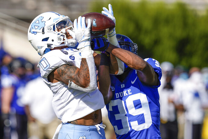 North Carolina wide receiver Emery Simmons (0) makes a touchdown catch against Duke Blue cornerback Jeremiah Lewis (39) during the first half of an NCAA college football game at Wallace Wade Stadium, Saturday, Nov. 7, 2020, in Durham, N.C. (Jim Dedmon/Pool Photo via AP)