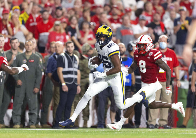 Michigan's Daylen Baldwin (85) carries the ball following a pass reception against Nebraska's Deontai Williams (8) during the second half of an NCAA college football game Saturday, Oct. 9, 2021, in Lincoln, Neb. (AP Photo/Rebecca S. Gratz)