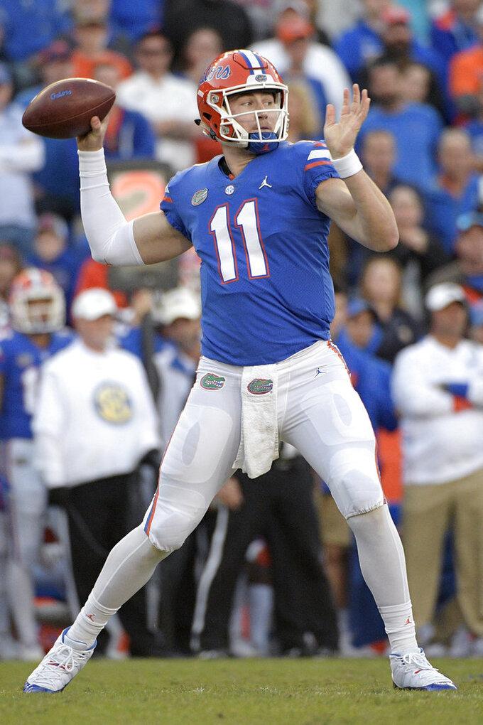 Florida quarterback Kyle Trask (11) throws a pass during the second half of an NCAA college football game against Missouri, Saturday, Nov. 3, 2018, in Gainesville, Fla. (AP Photo/Phelan M. Ebenhack)