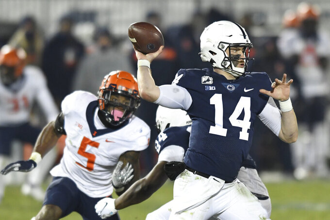 Penn State quarterback Sean Clifford (14) throws a second quarter touchdown pass to wide receiver Jahan Dotson as Illinois linebacker Milo Eifler (5) rushes him during an NCAA college football game in State College, Pa., on Saturday, Dec. 19, 2020. (AP Photo/Barry Reeger)