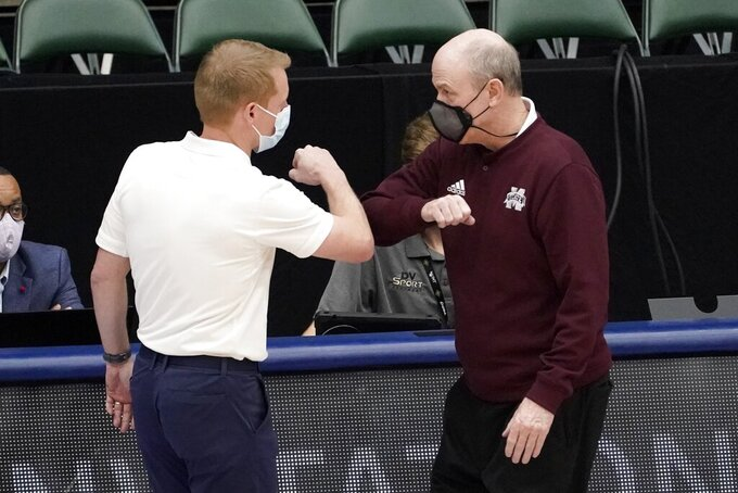 Louisiana Tech head coach Eric Konkol, left, and Mississippi State head coach Ben Howland, right, greet each other after an NCAA college basketball game in the semifinals of the NIT, Saturday, March 27, 2021, in Frisco, Texas. (AP Photo/Tony Gutierrez)