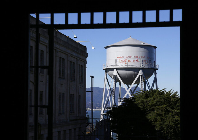 FILE - This Jan. 14, 2013, file photo, shows a restored water tower with words that read