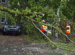 Workers remove a fallen tree blocking a road in Dartmouth, Nova Scotia. as Hurricane Dorian approaches on Saturday, Sept. 7, 2019.  Despite gradually transitioning to a post-tropical storm, Dorian will continue to be as strong as a Category 1. (Andrew Vaughan/The Canadian Press via AP)