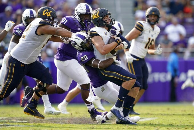 California quarterback Chase Garbers, right, is sacked by TCU safety La'Kendrick Van Zandt (20) in the second half of an NCAA college football game in Fort Worth, Texas, Saturday, Sept. 11, 2021. (AP Photo/Tony Gutierrez)