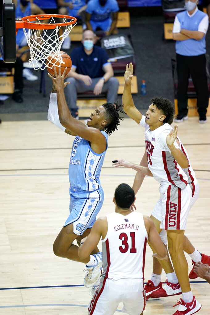 North Carolina forward Armando Bacot (5) drives the ball to the basket past UNLV forward Reece Brown (15) in the second half of an NCAA college basketball game in the Maui Invitational tournament, Monday, Nov. 30, 2020, in Asheville, N.C. (AP Photo/Kathy Kmonicek)