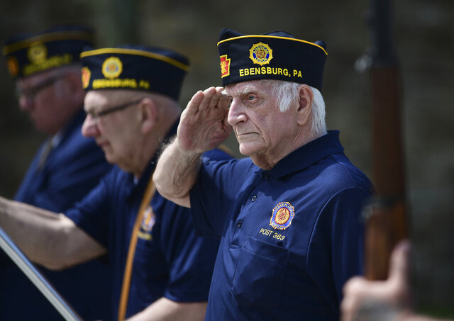 US Army veteran Joseph Lesniak of Colver, Pa., salutes during the playing of Taps at a Memorial Day ceremony at Soldiers and Sailors Memorial Park, in Ebensburg, Pa., Monday, May 25. 2020. (John Rucosky/The Tribune-Democrat via AP)