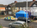 Police activity at a residential address in southwest London, Tuesday March 13, 2018.  According to a police statement Tuesday they are investigating the unexplained death of a man, being named as Russian businessman Nikolai Glushkov, who is associated with a prominent critic of the Kremlin. (AP Photo / Eva Ryan)
