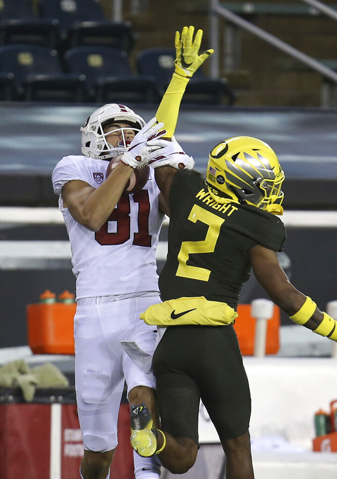 Stanford's Brycen Tremayne, left, pulls down a reception ahead of Oregon's Mykael Wright during the first quarter of an NCAA college football game Saturday, Nov. 7, 2020, in Eugene, Ore. (AP Photo/Chris Pietsch)