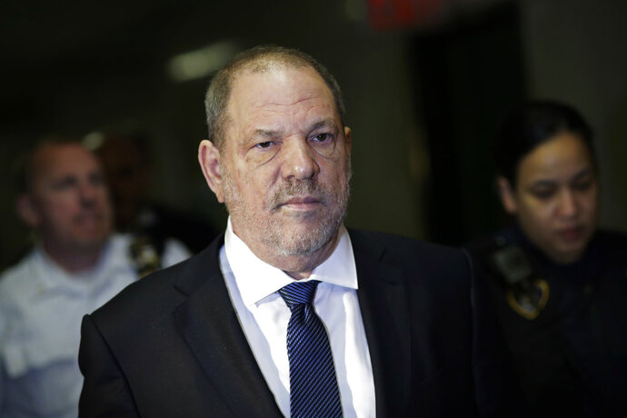 Harvey Weinstein enters State Supreme Court, Thursday, Oct. 11, 2018, in New York. Judge James Burke is expected to issue rulings Thursday on defense motions seeking to dismiss some or all of a six-count indictment accusing Weinstein of rape and sexual assault. (AP Photo/Mark Lennihan)