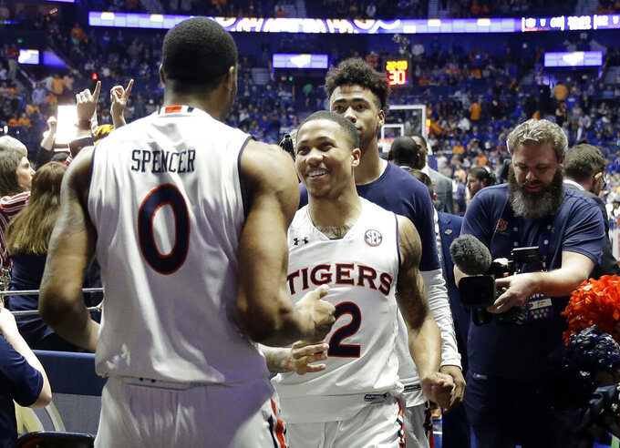 Auburn forward Horace Spencer (0) and guard J'Von McCormick (12) leave the court after beating Florida in an NCAA college basketball game at the Southeastern Conference tournament Saturday, March 16, 2019, in Nashville, Tenn. Auburn won 65-62. (AP Photo/Mark Humphrey)