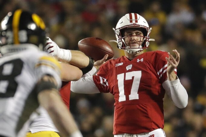 Wisconsin's Jack Coan throws during the second half of an NCAA college football game against Iowa Saturday, Nov. 9, 2019, in Madison, Wis. Wisconsin won 24-22. (AP Photo/Morry Gash)