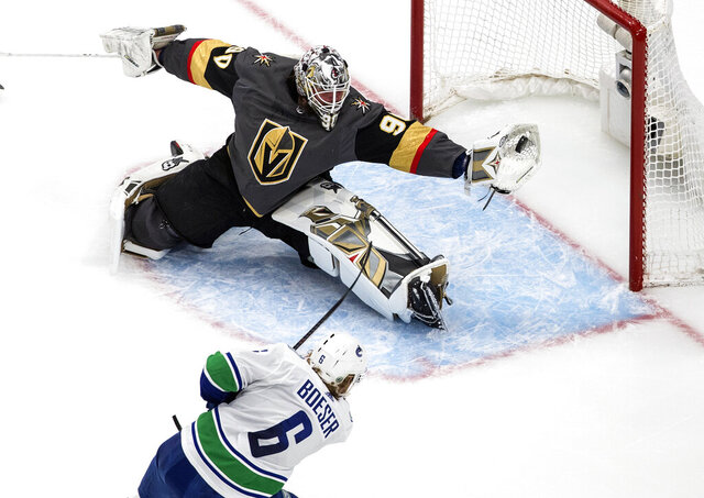 Vancouver Canucks' Brock Boeser (6) is stopped by Vegas Golden Knights goalie Robin Lehner (90) during second-period NHL Western Conference Stanley Cup playoff hockey action in Edmonton, Alberta, Friday, Sept. 4, 2020. (Jason Franson/The Canadian Press via AP)