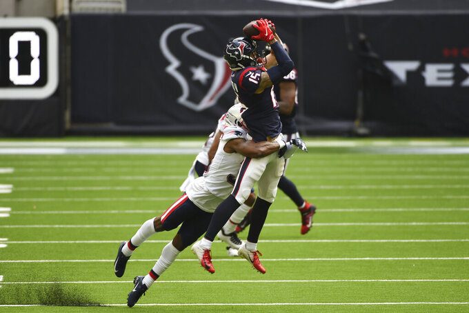 Houston Texans wide receiver Will Fuller (15) pulls down a catch over New England Patriots defensive back Jonathan Jones (31) during the second half of an NFL football game, Sunday, Nov. 22, 2020, in Houston. (AP Photo/Eric Christian Smith)