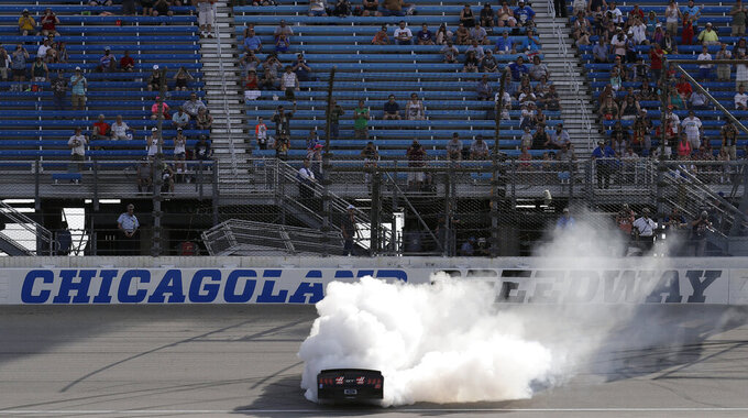 Cole Custer does a burnout after winning the NASCAR Xfinity Series auto race at Chicagoland Speedway in Joliet, Ill., Saturday, June 29, 2018. (AP Photo/Nam Y. Huh)