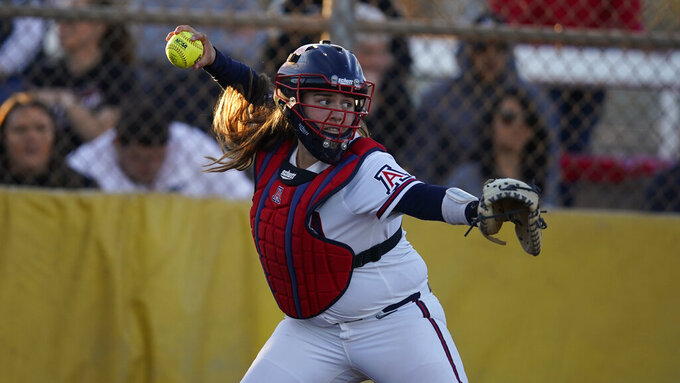 FILE - Arizona catcher Dejah Mulipola is shown during an NCAA college softball game against Seattle in Tempe, Ariz., in this Friday, Feb. 7, 2020, file photo. Division I softball is providing a training ground this season for players preparing for the 2021 Olympics. Mulipola is among 18 members of Team USA fighting for 15 spots on the squad that will go to Tokyo.(AP Photo/Rick Scuteri, File)