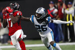 Atlanta Falcons wide receiver Olamide Zaccheaus (17) makes a catch against Carolina Panthers cornerback Donte Jackson (26) during the second half of an NFL football game, Sunday, Dec. 8, 2019, in Atlanta. ran for a touchdown on the play. Zaccheaus(AP Photo/John Bazemore)