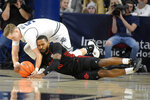 Utah State guard Sam Merrill (5) and San Diego State guard KJ Feagin (10) scramble for the ball during the first half of an NCAA college basketball game Saturday, Jan. 4, 2020, in Logan, Utah. (AP Photo/Eli Lucero)