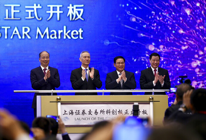 From left; Yi Huiman, Chairman of China Securities Regulatory Commission, Chinese Vice Premier Liu He, Shanghai Party Secretary Li Qiang, Shanghai mayor and Ying Yong applaud during a ceremony for the launch of the SSE STAR Market, previously referred to as the Shanghai Science and Technology Innovation Board, in Shanghai, Thursday, June 13, 2019. Chinese media say the country's top trade negotiator has told a forum in Shanghai that
