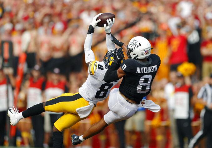 Iowa defensive back Matt Hankins (8) makes an interception in front of Iowa State wide receiver Xavier Hutchinson (8) during the first half of an NCAA college football game, Saturday, Sept. 11, 2021, in Ames, Iowa. (AP Photo/Matthew Putney)