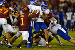 Kansas' Torry Locklin (12) is tackled by Iowa State defensive back Isheem Young (1) during the first half of an NCAA college football game, Saturday, Oct. 2, 2021, in Ames, Iowa. (AP Photo/Charlie Neibergall)