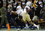 Tulsa wide receiver Keylon Stokes (2) scores a touchdown in front of teammate Keenen Johnson (8) and Navy cornerback Micah Farrar in the first half of an NCAA college football game, Saturday, Nov. 17, 2018, in Annapolis, Md. (AP Photo/Patrick Semansky)