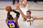 Los Angeles Lakers' LeBron James (23) takes a shot against Denver Nuggets' Michael Porter Jr. (1) during the second half of an NBA conference final playoff basketball game Saturday, Sept. 26, 2020, in Lake Buena Vista, Fla. (AP Photo/Mark J. Terrill)
