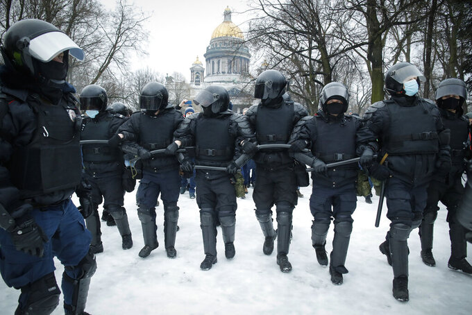 Police block demonstrators gathered to protest against the jailing of opposition leader Alexei Navalny in St. Petersburg, Russia, Saturday, Jan. 23, 2021. Russian police on Saturday arrested hundreds of protesters who took to the streets in temperatures as low as minus-50 C (minus-58 F) to demand the release of Alexei Navalny, the country's top opposition figure. Â Navalny, President Vladimir Putin's most prominent foe, was arrested on Jan. 17 when he returned to Moscow from Germany, where he had spent five months recovering from a severe nerve-agent poisoning that he blames on the Kremlin. (AP Photo/Dmitri Lovetsky)