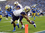 Washington running back Myles Gaskin lunges for the end zone trying to score against UCLA during the first half of an NCAA college football game Saturday, Oct. 6, 2018, in Pasadena, Calif. Gaskin was ruled out of bounds short of the goal line. (AP Photo/Marcio Jose Sanchez)