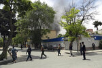 Afghan security personnel arrive near the site of an explosion in Kabul, Afghanistan, Wednesday, May 8, 2019. The Taliban attacked the offices of an international NGO, called Counterpart International, in the Afghan capital, setting off a huge explosion and battling Afghan security forces in an assault that wounded at least nine people, officials said. (AP Photo/Rahmat Gul)