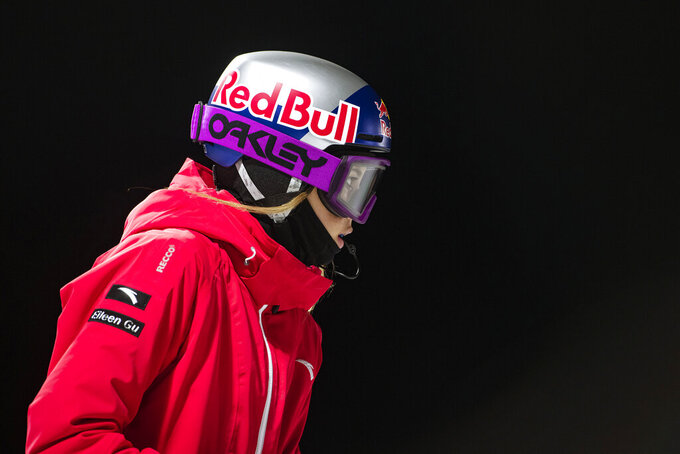 CORRECTS TO THE ASPEN TIMES, NOT THE ASPEN DAILY NEWS - Winter X Games rookie Eileen Gu prepares to drop into the superpipe during women's finals at the 2021 Winter X Games Aspen on Friday, Jan. 29, 2021, in Aspen, Colo. Gu took home the gold in her first superpipe final. (Kelsey Brunner/The Aspen Times via AP)